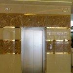 nouva-cream-and-spider-dark-marble-cladding